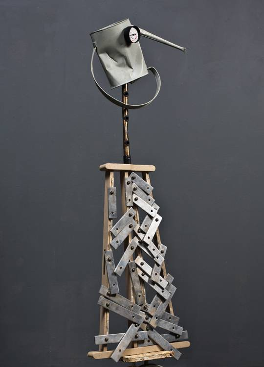 figurative abstract sculpture watering can xylophone